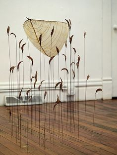 By Laura Tabakman.  This piece is interesting because it shows what isn't usually seen while in a canoe.