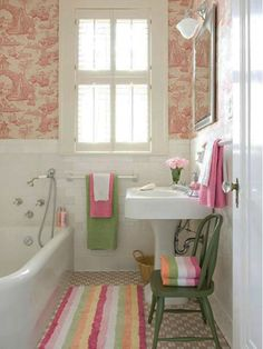 Small bathroom ideas - Home and Garden Design Idea's; Like the patterned wallpaper applied to top half of wall with coordinating colors in striped bath towels