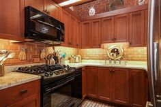 Inside the Small Frank Lloyd Wright home for sale in Ann Arbor MI - Small Kitchen Casas De Frank Lloyd Wright, Frank Loyd Wright Houses, Michigan, New Kitchen Designs, Kitchen Ideas, Brick Flooring, Professional Kitchen, Functional Kitchen, Wood Cabinets