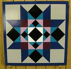Painted wooden Barn Quilts (Info: www.remillardsignsandbarnquilts.com) Washington Star This Washington Star pattern is hand painted using black, white, violet, purple, Kansas City teal, reflex blue and medium gr...