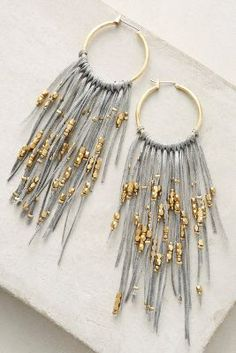 Anthropologie Lavina Hoop Earrings https://www.anthropologie.com/shop/lavina-hoop-earrings?cm_mmc=userselection-_-product-_-share-_-42279703