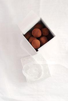 Trio of Truffles:  - Rosemary and Vanilla Bean Truffles  - Star Anise and Rose-Peppercorn Truffles  - Toasted Coriander Truffles
