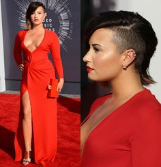 Demi Lovato went bold in a red Lanvin gown with a plunging neckline and thigh-high slit, which she paired with a red clutch. And, of course, she sported her new half-buzzed hair. But while there's nothing to hate about Demi's look, we didn't love it either. Thoughts?