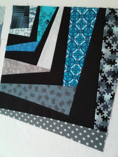 Wonky Corners tute. It looks easy enough. Trying to imagine a whole quilt made of the squares. Would be a pretty funky looking quilt!! -mrtrowell-
