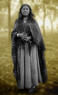 A Ute woman poses outdoors. Date: 1880-1900.