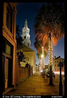 St Michael Episcopal Church, sidewalk, and palm trees at night. Charleston, South Carolina, USA