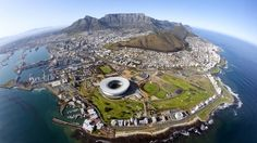 Living in: The world's most eco-friendly cities What's it like to live in a city committed to environmental protection and sustainable development? The answer might make you green with envy. - Cape Town, South Africa, eco-friendly, Table Mountain (Credit: Eric Nathan/Getty)