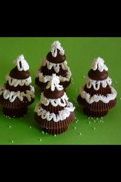 Mini Reese's, regular Reese's, Hershey's kisses and glue tighter with white chocolate. No link, picture only