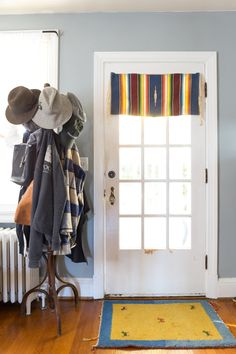 Color and Latin American prints greet us at the front door. This yellow rug is from Circa.