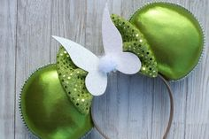 Tinkerbell Minnie Mouse Ears Faith, Trust and Pixie Dust! I love these classy Tinkerbell Minnie Ears! So shiny, they will gleam in the sunshine! DETAILS: - Each headband is carefully handcrafted with high-quality fabric. - Every pair of ears is especially made to order for you,