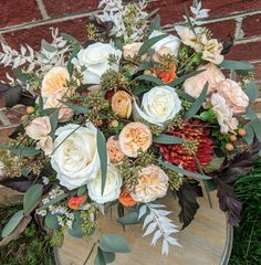 Fall rustic bouquet with roses, mums, bleached ruscus, diablo ninebark and more in a cream and peach palette with rust orange accents.