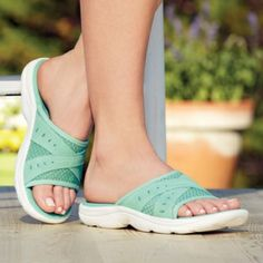 Easy Spirit Women's Off Duty Slide Sandals — less weight on your feet to lighten steps as you go! These sandals have a durable Elon outsole that helps keep the sandal flexible. Gel cushioning in the footbed absorbs shock and rebounds with each step for comfort that lasts over time.