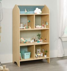 The Sauder Pinwheel Dollhouse Bookcase adds some decorative yet functional decor to your kid's space. Featuring doll-house inspired details with an ash finish, this dreamy dollhouse bookcase adds style and storage to your child's room. Dollhouse Bookcase, Diy Dollhouse, Kids Furniture, Luxury Furniture, Furniture Market, Furniture Online, Furniture Stores, Cheap Furniture, Office Furniture
