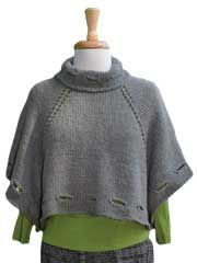 """Knit """"square peg"""" poncho with classy detailing. Holes along the bottom add a bit of edginess."""