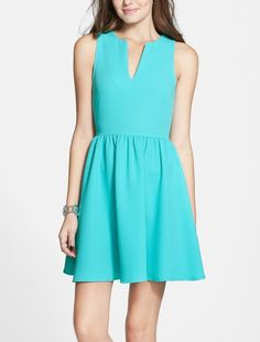 Adding boots and a fitted moto jacket to this skater dress.