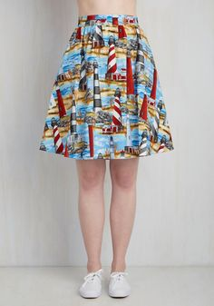 Give that big project your all 'cause after it's all over, this quirky cotton skirt is ready to be worn to brunch! Patterned with all lighthouses built up from sandy spots in the sea, this colorful bottom brings motivation to your task completion.