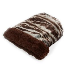 Susan Lanci's Koala Dark Cuddle Cup with Chocolate Shag is the ultimate dog bed for your furry friend when it comes to style and comfort. This luxurious, designer dog bed is three products in one; the sides can roll over to form a bed; it can lie on its s