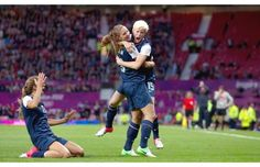 The United States' Megan Rapinoe celebrates with teammate Alex Morgan as Tobin Heath slides in on her knees after scoring against Canada during their semifinal women's soccer match at the 2012 London Summer Olympics, on Monday, Aug. 6, 2012, at Old Trafford Stadium in Manchester, England.