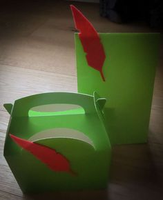 Definitely want to do a green bag and red feather for the boys. Olivia's 2nd Birthday  | CatchMyParty.com