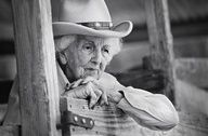 """Connie Reeves  Kerrville, Texas  At 101 years old, Connie was still riding her horse every day. She taught over 36,000 girls to ride at a girls summer camp over a span of 70 years. She was a huge inspiration to many people. Her health was great and her mind was sharp. I asked her what her secret to longevity was. She said, """"Well Honey, you just don't let that rocking chair take over…you get up and go even if you don't want to.""""  The American Cowgirl Project"""