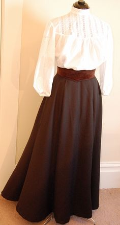 1905 school teacher attire (replica) for the Museum of the Great Plains in Oklahoma. The shirtwaist is Gibson style, popular in the early 1900s. It is made of fine cotton batiste, and has extensive pintucking and insets of antique lace. The shaped belt adds to the S-curve silhouette. The worsted wool skirt is lined, and the flared shape is typical of the Edwardian style.