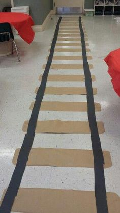 Polar express train track in classroom Continue Reading → Polar Express Christmas Party, Polar Express Party, Polar Express Train, Ward Christmas Party, Christmas Themes, Office Christmas, Train Crafts, Vbs Crafts, Cardboard Crafts