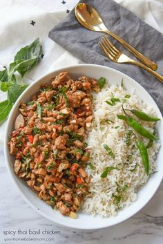 SPICY THAI BASIL CHICKEN is one of those meals that quickly becomes a family favorite.  It's easy and full of amazing flavor!