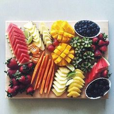 so many yummy fruits; watermelon, strawberries, mango, kiwi, blackberries, blueberries, apple, mandarin, lime x