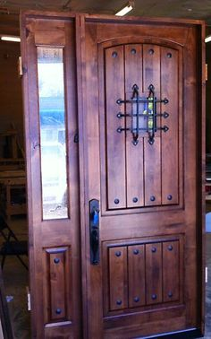 Rustic wood door with single sidelight. We have this type of front door on our house in a lighter shade.