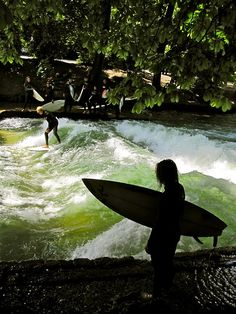 Munich. The permanent wave, in one of Munich's parks. Formed by water emerging from an underground tunnel, you can surf the same spot for hours, without ever having to get off your board. If you are good enough.
