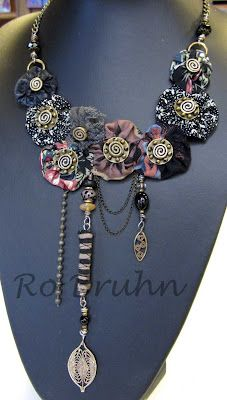 Ro Bruhn - Fabric yo yos with brass bead centres.  Consider that FB's could be made to match fabric....