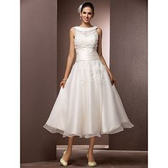 If only it were floor length...   I love the neckline, the details at the back, and the band at the waist with the flare below.   (A-line Bateau Tea-length Organza Wedding Dress With A Wrap – USD $ 199.99)