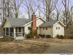 Sold for $133,000 - was For sale: $149,000. -Charming cottage, largely wooded 2.26 ac lot, bordered by S Hominy Creek. High ceilings in living room, wood-paneled ceilings in living and updated kitchen. Wood flooring. Updated Bath. Rear deck to enjoy the setting. Beautiful setting in area of nice properties. Tenant on month-to-month lease.