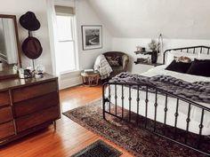 Funky Victorian Home Tour White bedroom with black metal bed frame, vintage rug, floating shelf nigh Black Metal Bed Frame, Metal Bed Frames, White Metal Bed, Black Iron Beds, Black Beds, Mid Century Modern Bedroom, Modern Victorian Bedroom, Simple Bed, Black Bedding