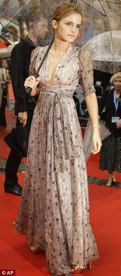 Emma Watson's dress is so pretty. It's a free-flowing vintage 1970s Ozzi Clark dress.