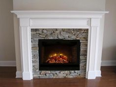 Attractive and affordable, the Danbury standard size, quick ship traditional fireplace mantel surround adds extra character to rooms with a framed wooden panel motif. Wood Stove Fireplace Insert, Faux Fireplace Mantels, Fireplace Mantel Surrounds, Home Fireplace, Fireplace Remodel, Fireplace Inserts, Fireplace Design, Fireplace Ideas, Fireplace Stores