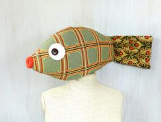 Fish pillow Kids room decor Nautical pillow Lake house pillow Colorful fish Sweet soft Coastal decor Valentine gift Kiss me  Fish pillow sewn of colorful decorative textile Size (with tail fin): ca 26 × 9 × 4 (65 × 22.5 × 10 cm)  You can use this fish as a pillow at home and when travelling.   Made in a smoke free house.  Ready to ship.   Please check dimensions carefully. Due to lighting conditions and monitor settings, colors may appear slightly different, than they are. Items are…