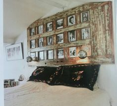 Old door frame as picture frame above bed. Amazing!