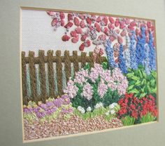 My mum's embroidery. Garden fence detail one of a set of four embroideries. Completed from a kit by Rowandean.
