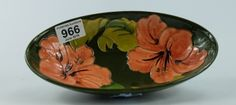 Collectors & General Auction – Lot 966 – Moorcroft Hibiscus on green ground oval bowl length 23cm.  Sale Price £32.00