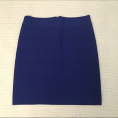 bebe Bandage/Bodycon Skirt Bright blue bebe bandage skirt with silver zipper in the back. Only worn once. Great form fitting skirt holds you in! 17 inches long, 13 inches wide. It's a very stretchy material. bebe Skirts Midi