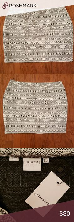 Skirt NWT. Junarose skirt. Very cute textured southwest pattern in black and winter white. 22 inches long from waist to hem so hits just above the knee. Would look cute with tights and boots or flats and a chunky sweater. Poly cotton elastin blend. Junarose Skirts Mini