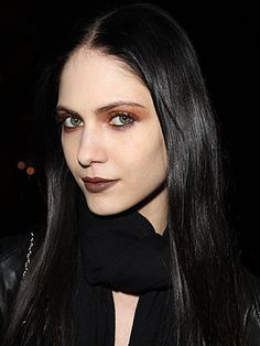 Dark plum (almost black) lips brought back the 90's at Givenchy, especially as they were paired with a heavy, plum smoky eye. The modern twist? A touch of burnished orange shadows on the brow bone brought it back to date