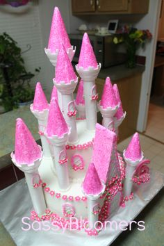 Castle Cake Princess Cake  This is what the cake ended up looking like that we made using the Wilton Castle Cake kit and flowers from Cupcakes by Christy https://www.facebook.com/CupcakesbyChristy. The birthday girl was very pleased!