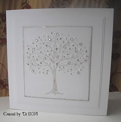 The gilding flakes won this round - there wasn't really enough coverage on this gorgeous Penny Black tree.  I added three Stickles and two Liquid Pearls as well as some gems to it, so you can hardly tell!  I added a couple of white layers as I wanted to keep the design very clean but the card needed a little something extra and I think the white layers worked well.