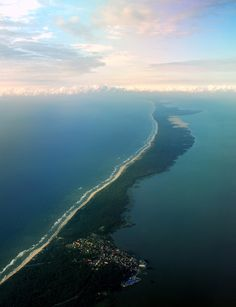 The Curonian Spit - a 98 km long, thin, curved sand-dune spit that separates the Curonian Lagoon from the Baltic Sea coast.  Its southern portion lies within Kaliningrad Oblast, Russia and its northern within southwestern Lithuania. It is a UNESCO World Heritage Site shared by the two countries.