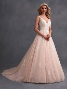 A Full Length, Traditional Wedding Gown with Ball Gown Silhouette, Lace Bodice, V-Shaped Neckline, and Chapel Train