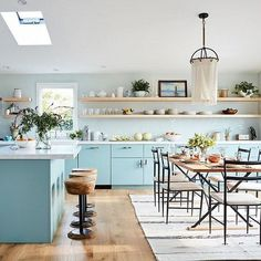 VerifiedIn @driverminnie's seaside Malibu home, a multi-room reno by the design team at @onekingslane turned the cluttered cottage into a restful, beautiful, and functional space. Cheery blue lower cabinets (our DIY Slab fronts!), light countertops, and open upper shelving help the space feel airy and open, perfect for entertaining groups of family and friends. Tap the link in our bio for the full tour. Photos by @treasurbite, design by @onekingslane.