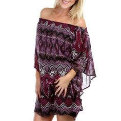 Sweet off-the-shoulder dress with an intricate print with mix of deep purples and reds.  Fun dress to wear for a night out on the town.