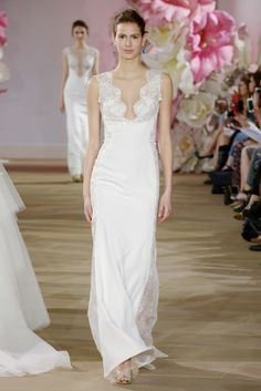 Ines Di Santo 'Sultry' gown  Sleeveless sheath gown with scalloped V neckline and dramatic embellished cut-outs at side.